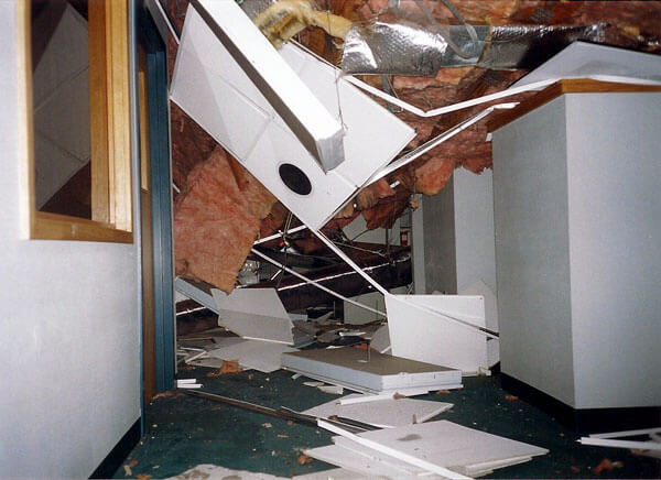 An ice storm causes the Lottery Headquarters roof to collapse, with everyone getting out safely
